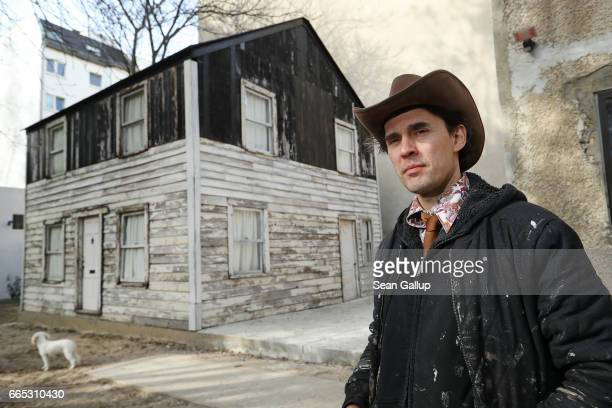 Artist Ryan Mendoza poses for a photo next to the former house of Afro-American human rights figure Rosa Parks on Mendoza's property on April 6, 2017...