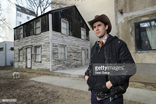 S artist Ryan Mendoza poses for a photo next to the former house of AfroAmerican human rights figure Rosa Parks on Mendoza's property on April 6 2017...