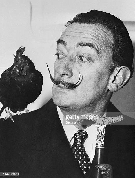 Artist Salvador Dali arrives in New York with a rooster named Oscar, whose acquaintance he made on his trip
