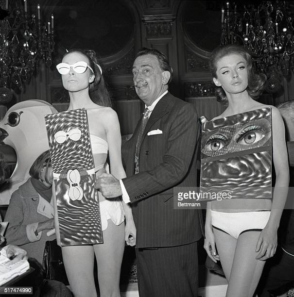 Artist Salvador Dali checks models wearing Dalidesigned bathing suits during May 4th fashion show featuring his debut as couturier The Dali...