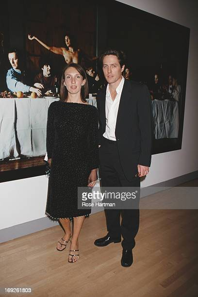 Artist Sam Taylor-Wood and actor Hugh Grant in front of Taylor-Wood's 'Wrecked' at the Sensation Benefit and Exhibition Preview at the Brooklyn...