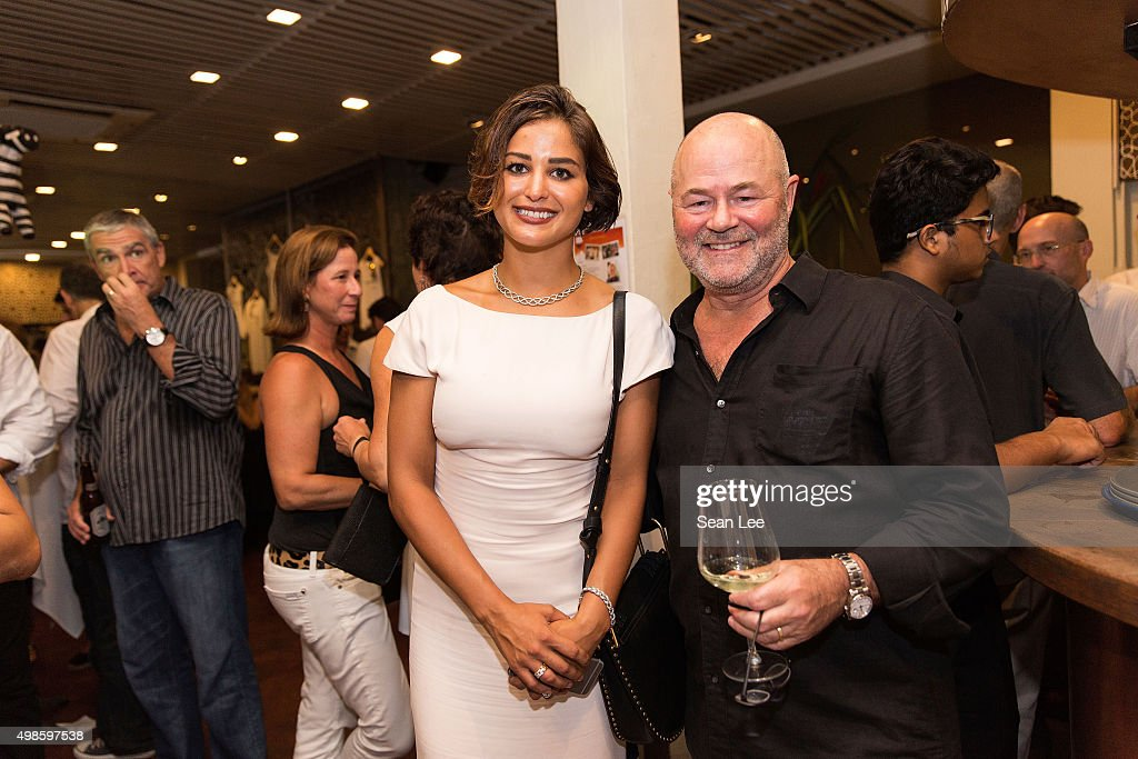 Artist Sara Von Kienegger and Bill Cornwell at the Original Sin hosted charity fund raising party for the benefit of Truyen Tin Orphanage on November 21, 2015 in Singapore.