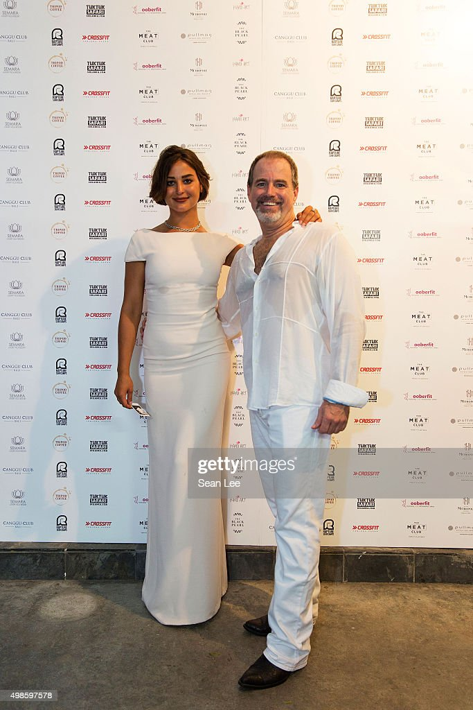 Artist Sara Von Kienegger (L) with event host Mike Hadley at the Original Sin hosted charity fund raising party for the benefit of Truyen Tin Orphanage on November 21, 2015 in Singapore.