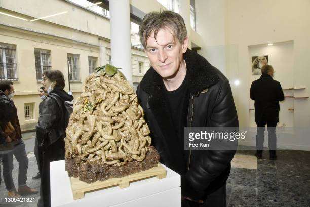 """Artist Sébastien Gouju poses with his work during """"Ils Ont Dit Oui"""" Exhibition an Amalteo Institute Project Curated by Marc Molk at Galerie..."""