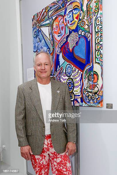 Artist Scott Christopher poses with his artwork during the Clen Gallery Art Exhibition at Rogue Space on October 17 2013 in New York City