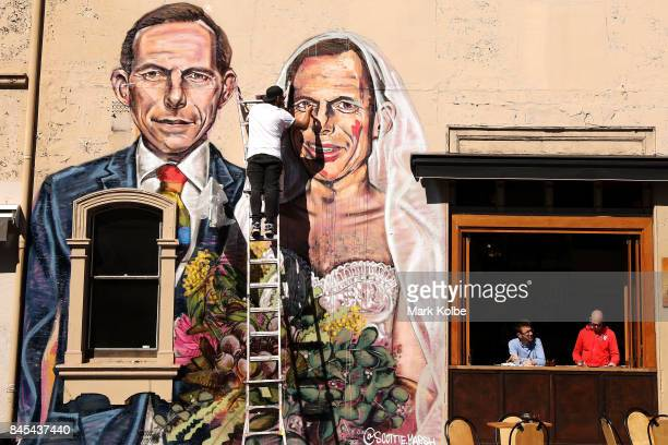 Artist Scott Marsh paints a mural depicting former Prime Minister Tony Abbott in Redfern on September 11 2017 in Sydney Australia Australians are set...