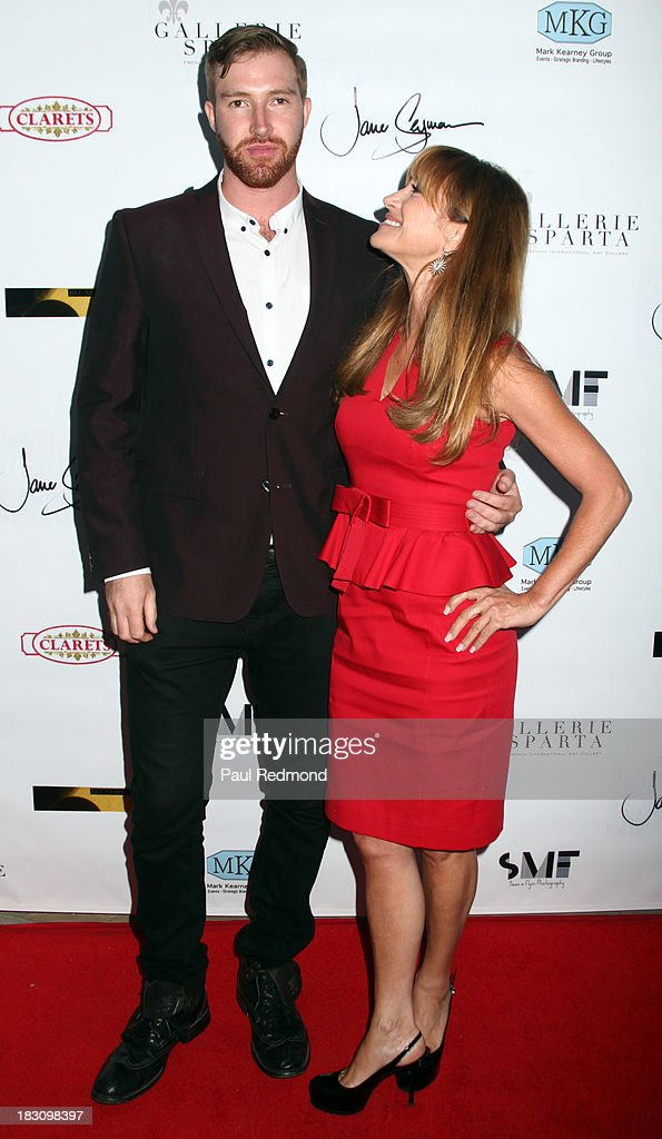 Artist Sean M. Flynn and his mother, actress Jane Seymour attend Jane Seymour Art Exhibition Opening Benefiting Open Hearts Foundation at Gallerie Sparta on October 3, 2013 in West Hollywood, California.