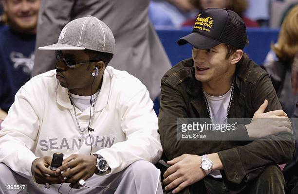 Artist Sean P Diddy Combs and actor Ashton Kutcher sit courtside at the game between the Boston Celtics and the New Jersey Nets in Game two of the...
