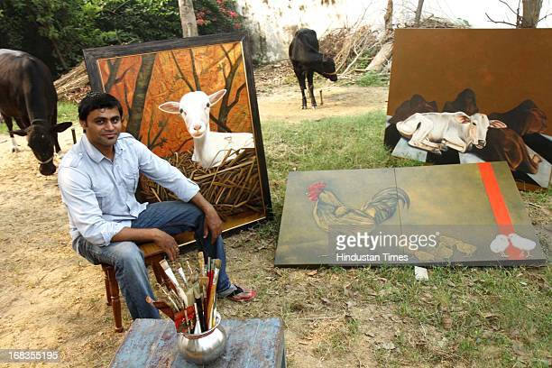 Artist Shailendra Singh with his work at his home in Nazafgarh on October 20 2010 in New Delhi India