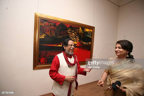 Artist Shakti Barman has a word with actress Sharmila Tagore at the inauguration of Paresh Maity's show The World On A canvas in New Delhi on March...