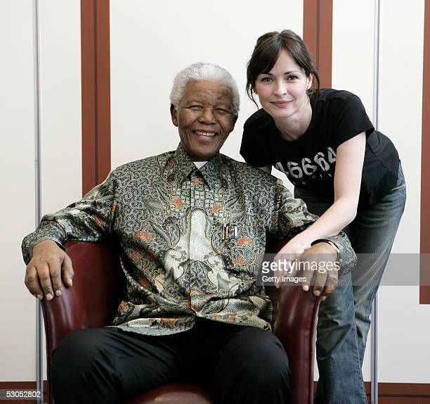 46664 artist Sharon Corr poses with Nelson Mandela at a photocall ahead of tonight's '46664 Arctic' concert at the Rica Hotel on June 11 2005 in...