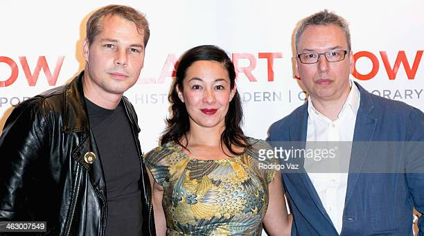 Artist Shepard Fairey Amanda Fairey and Paul Stolper attend the LA Art Show 2014 Opening Night Premiere Party at Los Angeles Convention Center on...