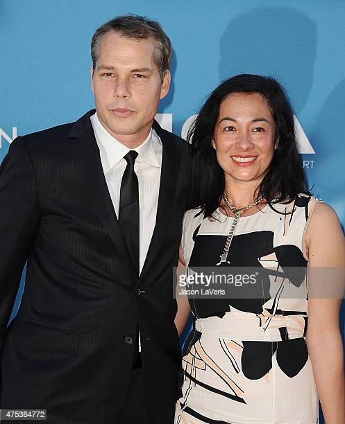 Artist Shepard Fairey and wife Amanda Fairey attend the 2015 MOCA Gala at The Geffen Contemporary at MOCA on May 30 2015 in Los Angeles California