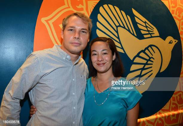Artist Shepard Fairey and wife Amanda Fairey attend the offcial unveiling of a wall that he donated to the USC Hospital through the art of Elysium's...