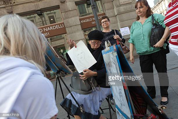 Artist showing her work in on the Via Mercanti,