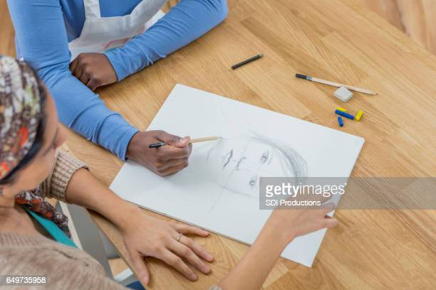 artist sketches a self portrait - self portrait stock pictures, royalty-free photos & images
