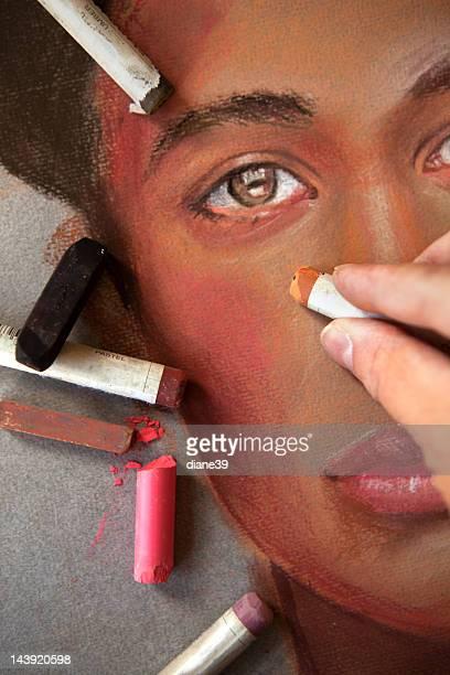 Artiste dessiner un visage avec des tons pastel