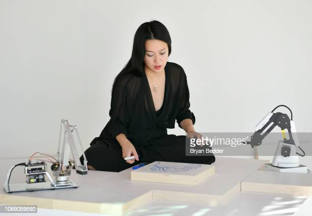 Artist Sougwen Chung performs live art during the American Express Platinum House At The 1 Hotel South Beach on December 6, 2018 in Miami Beach,...