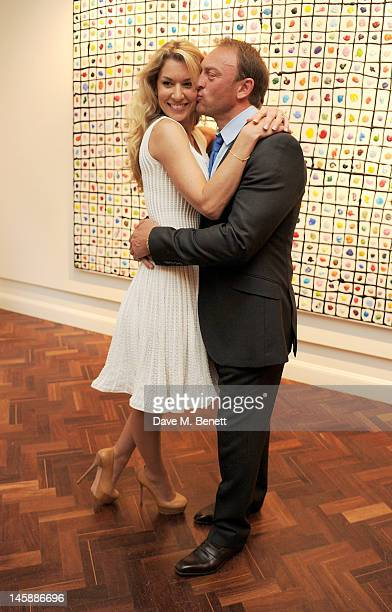Artist Stasha Palos and Tony Lewis attend a private viewing of 'Colour: An Exhibition By Stasha', featuring works by Stasha Palos, at The Gallery In...