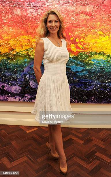 Artist Stasha Palos attends a private viewing of 'Colour: An Exhibition By Stasha', featuring works by Stasha Palos, at The Gallery In Cork Street on...