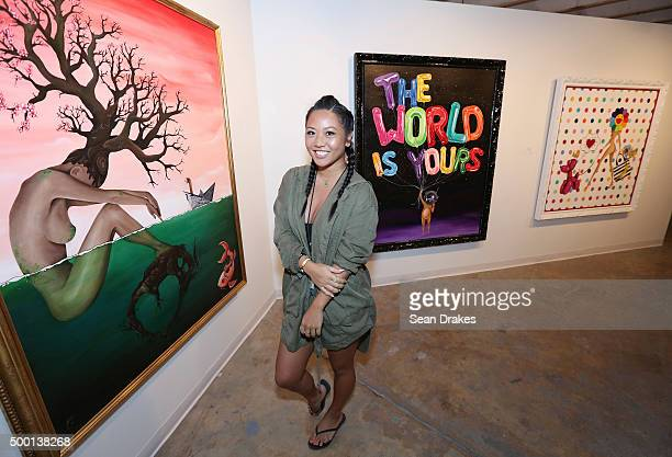 Artist Sue Tsai poses with her art at the No Commission art fair presented by the Dean Collection and Casa Bacardi during Art Basel Miami Beach on...