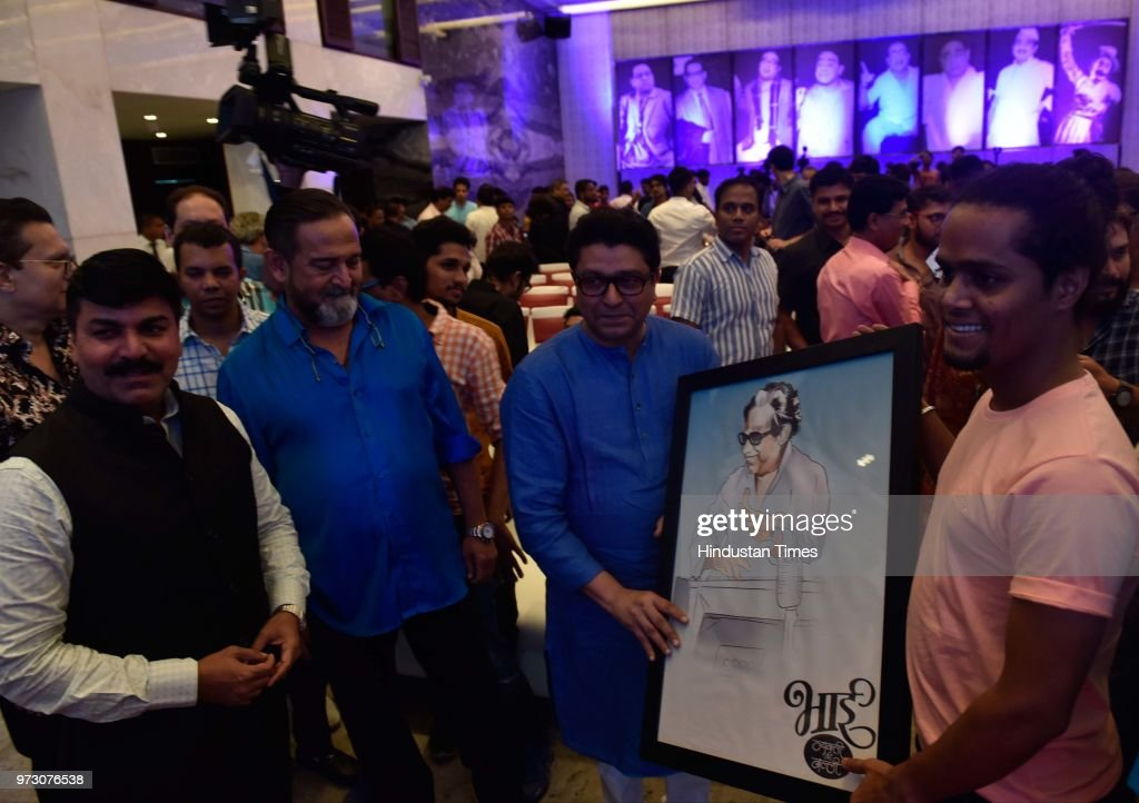Artist Sushant Devruhkar presents painting to MNS Chief Raj Thackeray as Shiv Sena leader Rahul Shewale looks on during an announcement of biopic 'Bhai- Vyakti Ki Valli' on renowned homorist PL Deshpande, popularly known as Pu La, slated for release in January next year, directed by filmmaker-actor Mahesh Manjrekar, at Blue Sea, Worli, on June 11, 2018 in Mumbai, India.