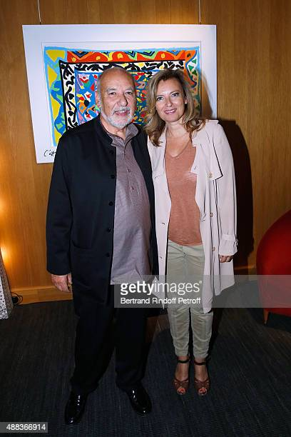 Artist Tahar Ben Jelloun and Valerie Trierweiler attend the 'Paintings Poems from Tahar Ben Jelloun Furniture Scriptures from CSaccomanno ODayot'...