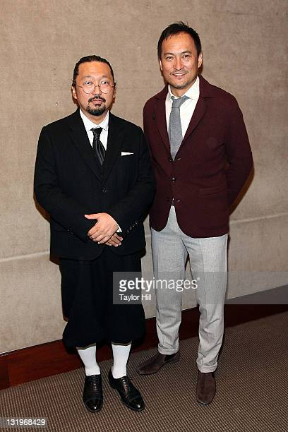 Artist Takashi Murakami and actor Ken Watanabe attend the Artists for Japan charity auction at Christie's on November 9 2011 in New York City The...