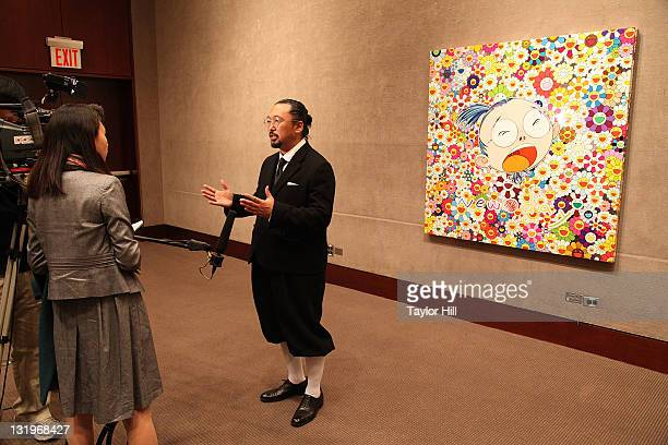 Artist Takashi Murakami is interviewed in front of 'New day Face of the Artist' at the Artists for Japan charity auction at Christie's on November 9...