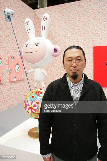 Artist Takashi Murakami poses next to 'Kaikai' at the MOCA Los Angeles media preview of Murakami at The Geffen Contemporary at MOCA on October 26...