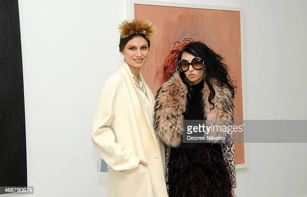 Artist Tali Lennox and designer Stacey Bendet attend Tali Lennox Exhibition Opening Reception at Catherine Ahnell Gallery on March 18 2015 in New...