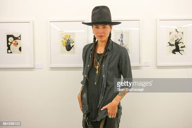 Artist Tasya van Ree poses in front of her artwork at OptiMystic A Brandon Boyd Pop Up Gallery Featuring He Tasya Van Ree Natalie Bergman Diana...