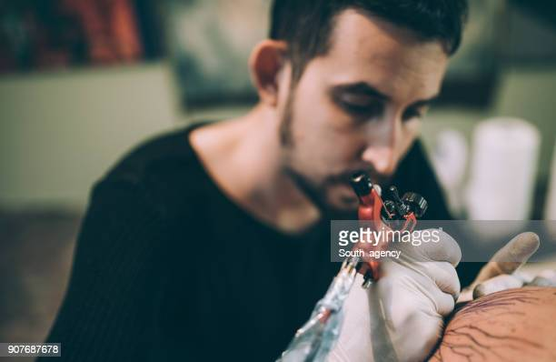 Artist tattooing