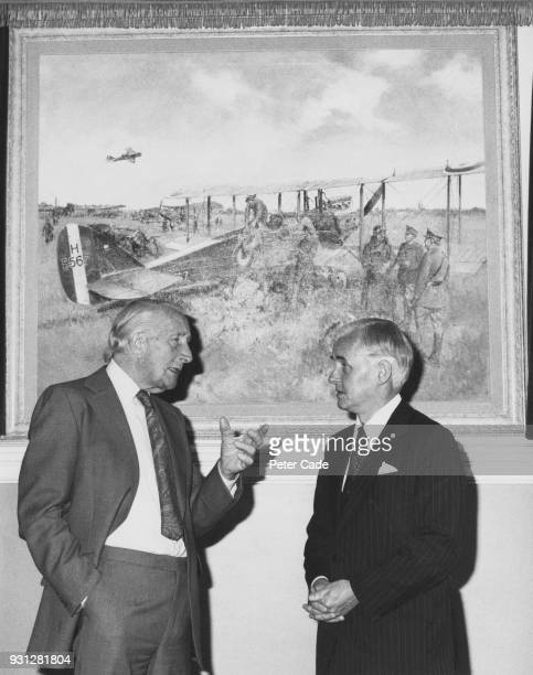 Artist Terence Cuneo a former Royal Engineer talks to Sir William Barlow chairman of the Post Office after the unveiling of Cuneo's picture...