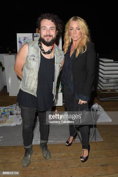 Artist Tiago Magro and Anna Rothschild attend Rosario Dawson Hosts The Launch Of Photo Butler At Art Basel With Anna Rothschild And Claudine De Niro...