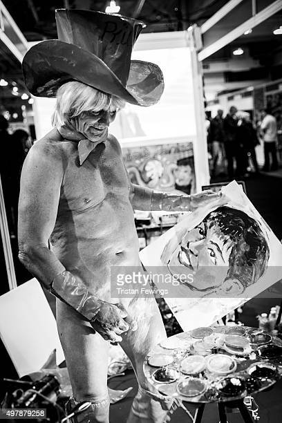 Artist Tim Patch AKA Pricasso paints during the annual Sexpo convention at Olympia Exhibition Centre on November 13 2015 in London England