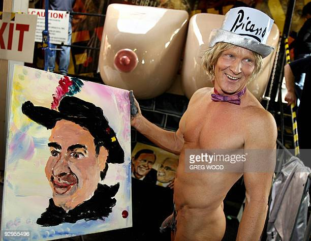 Artist Tim Patch who prefers to be known as Pricasso smiles after using his penis to paint a portrait of penis puppeteer Alan Length during the...