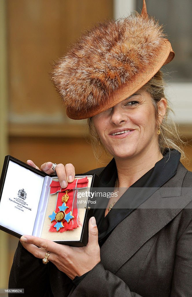 Artist Tracey Emin proudly holds her CBE award after the Investiture Ceremony at Buckingham Palace on March 07, 2013 in London, England.