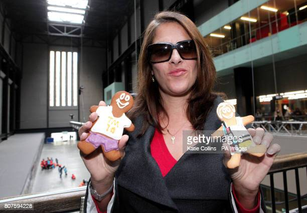 Artist Tracey Emin with two Tate Modern 10th birthday gingerbread men during the Tate Modern 10th birthday cake cutting event at the Tate Gallery...
