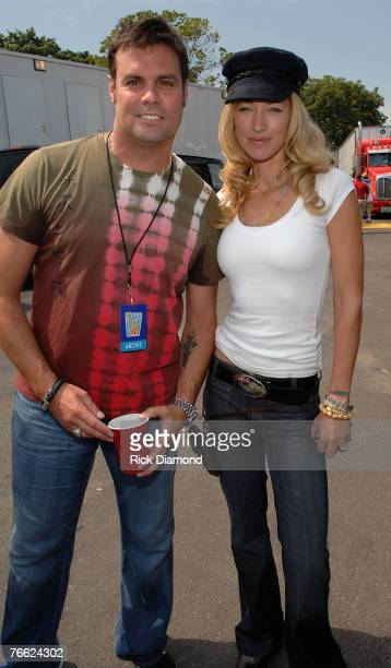 Artist Troy Gentry of Montgomery Gentry and Model Elaine Erwin Mellencamp Backstage at Farm Aid 2007 at ICAHN Stadium on Randall's Island NY...