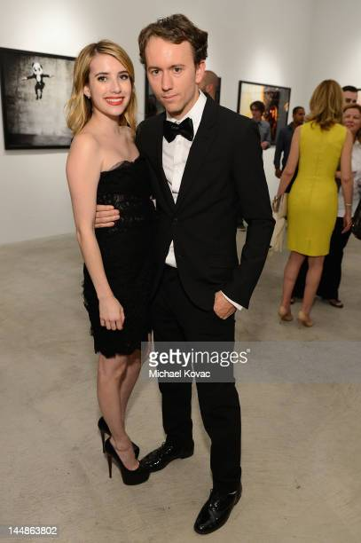 Artist Tyler Shields and actress Emma Roberts attend Tyler Shields debut of MOUTHFUL presented by A/X Armani Exchange in support of LOVE IS LOUDER at...