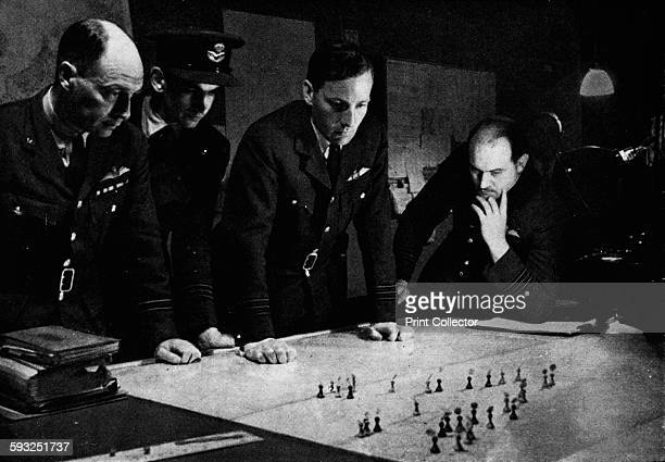 Artist Unknown RAF Bomber Command operations room during a raid 1941 Meanwhile at the Station the positions of the raiding aircraft are now being...