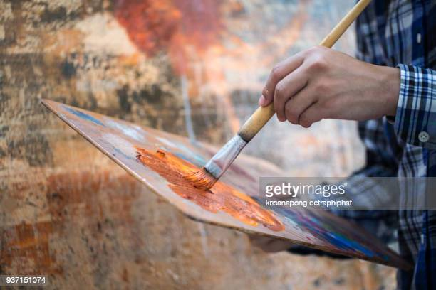 artist using drawing brushes. - canvas stock pictures, royalty-free photos & images