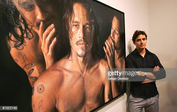 Artist Vincent Fantauzzo poses beside his winning entry a portrait of the late actor Heather Ledger titled 'Heath' awarded as the winner of the...