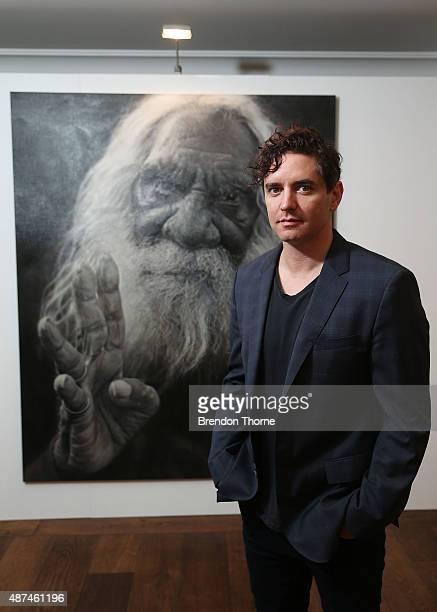 Artist, Vincent Fantauzzo poses in front of his portrait 'Kudditji' on September 10, 2015 in Sydney, Australia.