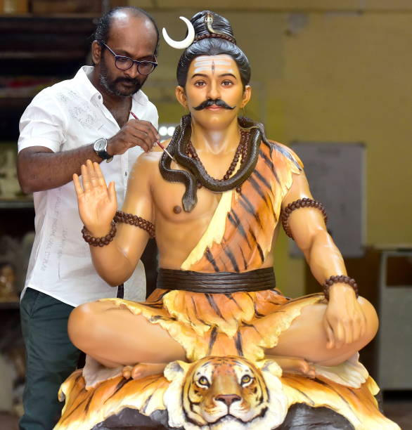 IND: Artist Vishal Shinde Gives Final Touch To Idol Of Lord Shiva For Upcoming Mahashivratri Festival