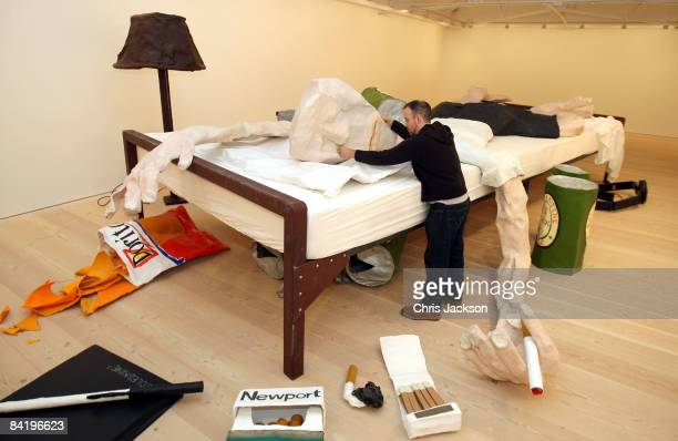 Artist Will Ryman puts some finishing touches to his installation entitled 'The Bed' at the Saatchi Gallery in Chelsea on January 7 2008 in London...