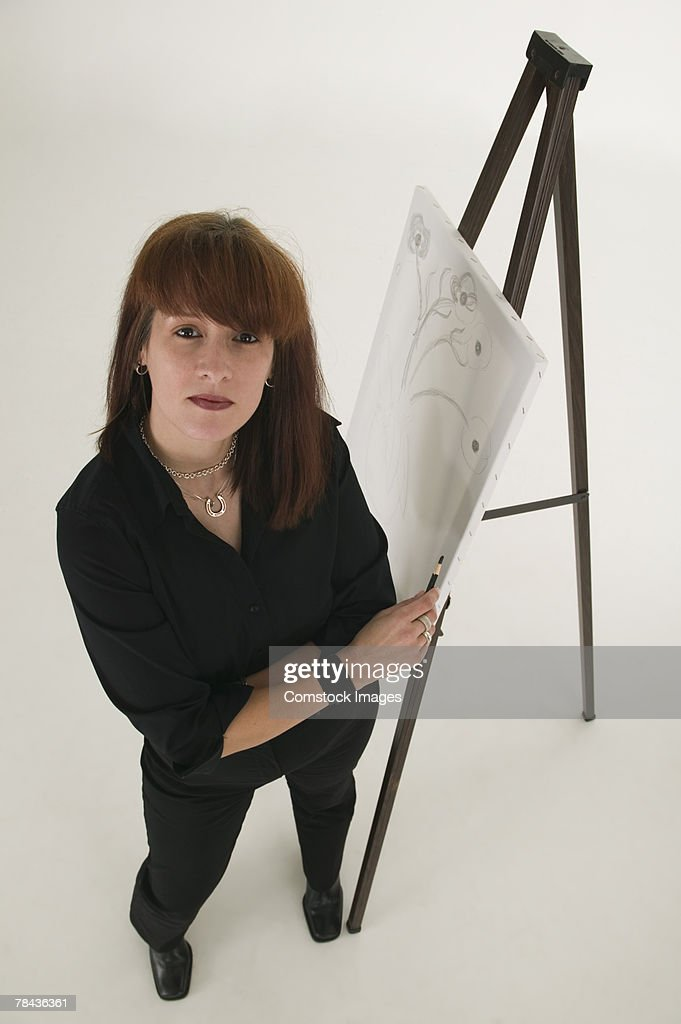 Artist with easel : Foto de stock