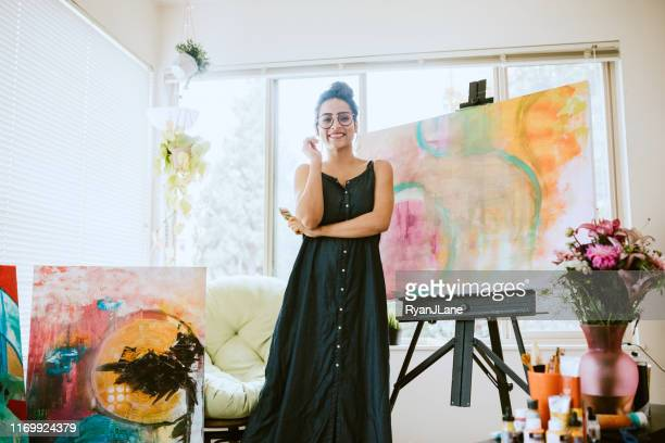 artist woman painting in home studio - artist stock pictures, royalty-free photos & images