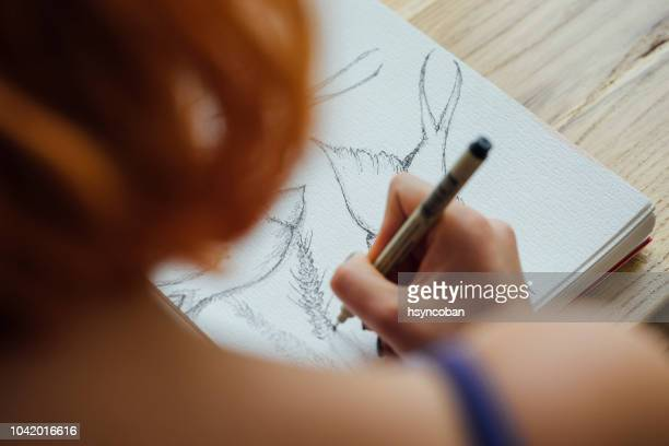 artist working at coffee shop - drawing art product stock pictures, royalty-free photos & images